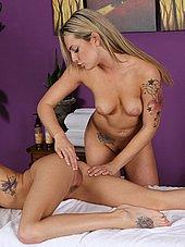 Hot blonde masseuse reaching for blonde clients ass