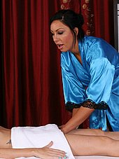 horny masseuse reaching for clients pussy